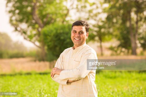 indian farmer at field - stock image - kurta stock pictures, royalty-free photos & images
