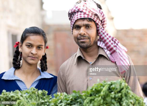 Indian farmer with daughter