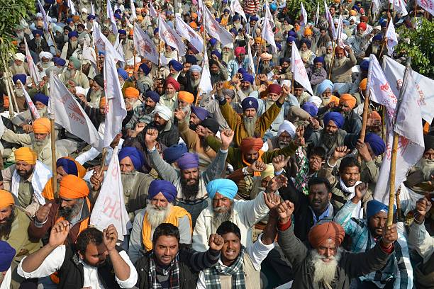 Indian farmers from Kisan Sangharsh Committee shout slogans during a protest against the Punjab State Electricity Regulatory Commission and the state.