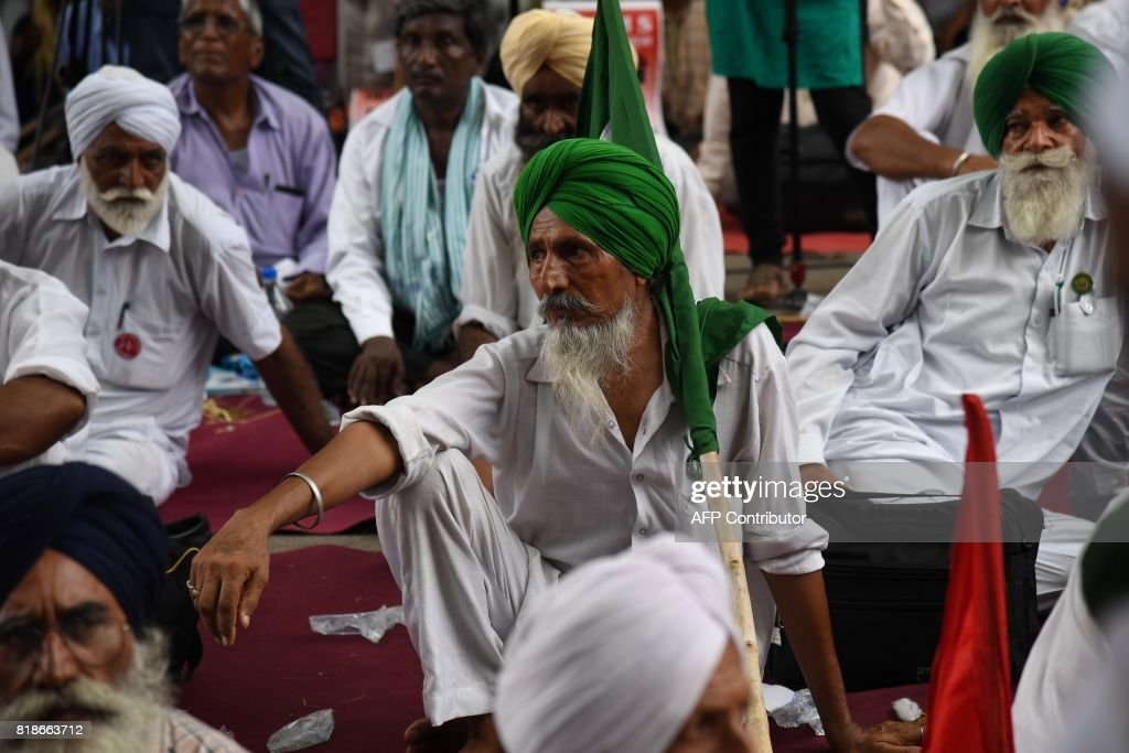 Indian farmers from the state of Punjab listen to a speech during a protest in New Delhi on July 19 2017 Farmers from the states of Maharastra Punjab.