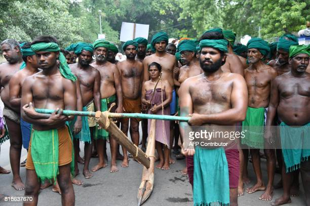 Indian farmers from the state of Tamilnadu plough symbolically during a protest in New Delhi on July 19 2017 More than 200 farmers are reported to...