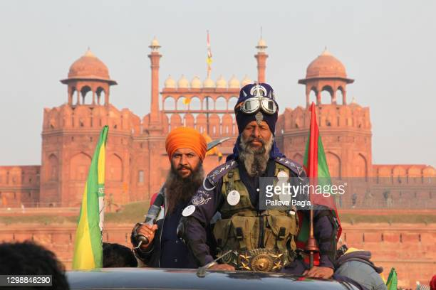 Indian farmers gather at the iconic Red Fort during Republic Day to protest over new farming laws on January 26, 2021 in in New Delhi, India. Some...
