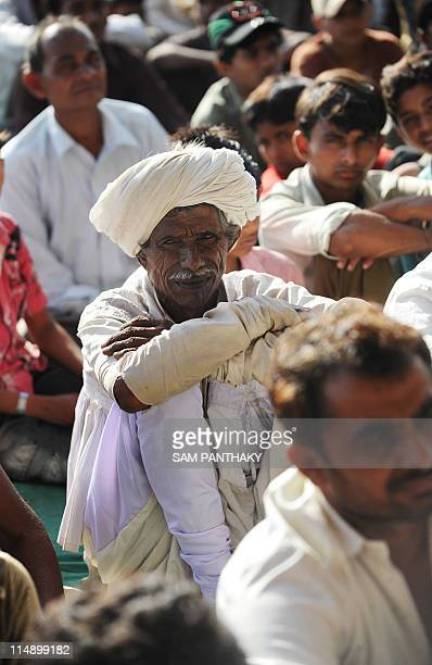 Indian farmers gather for a protest meeting at Meethi Virdi village in Bhavnagar district some 260 kms from Ahmedabad on May 27 2011 Villagers from...