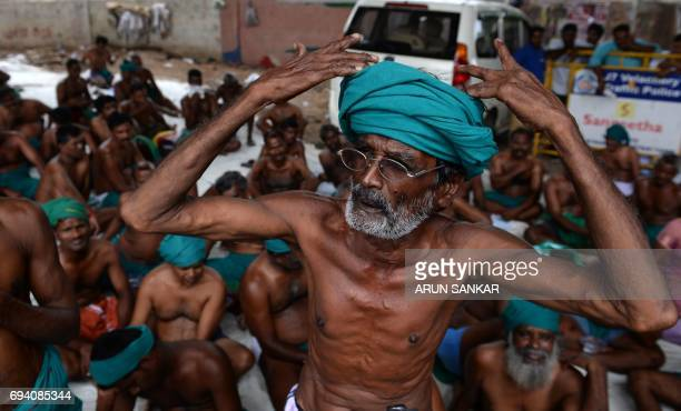 Indian farmers gather on a footpath during a protest in Chennai on June 9 2017 Tamil Nadu state farmers are protesting as they demand profitable...
