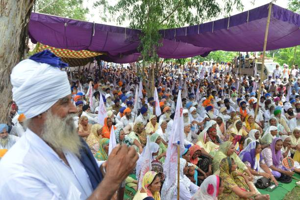 Indian farmers listen to a speaker during a protest against the Punjab State Electricity Regulatory Commission and state government rise of...