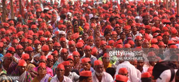 Indian farmers listen to speakers at the site of a protest rally in Mumbai on March 12 2018 Tens of thousands of Indian farmers protested in Mumbai...
