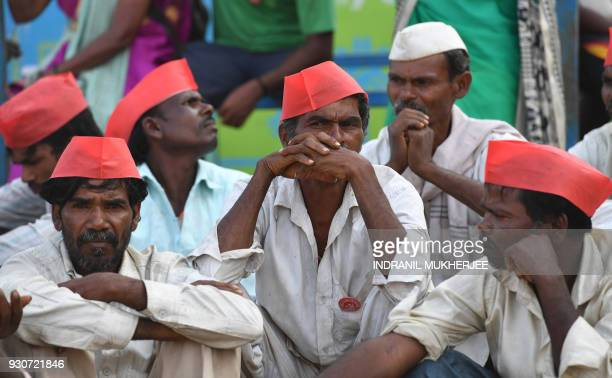 Indian farmers look on at the site of a protest rally in Mumbai on March 12 2018 Tens of thousands of Indian farmers protested in Mumbai on March 12...