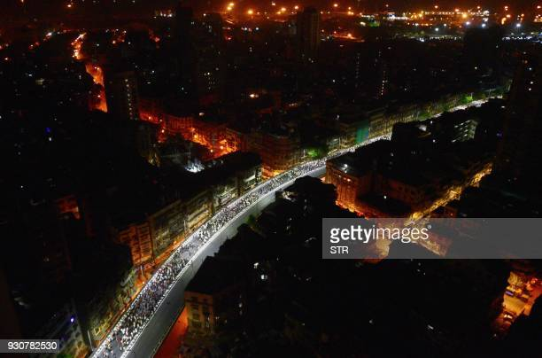 Indian farmers march along a road early morning in Mumbai on March 12 2018 Tens of thousands of Indian farmers protested in Mumbai March 12 after...