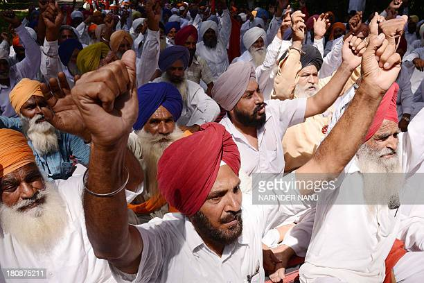 Indian farmers participate in a protest against the central and state government in Amritsar on September 17 2013 Farmers protested against alleged...