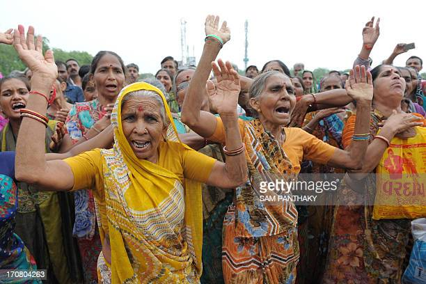 Indian farmers protest during a rally in Gandhinagar capital of India's Gujarat state some 30 kms from Ahmedabad on June 18 2013 Nearly 5000 farmers...