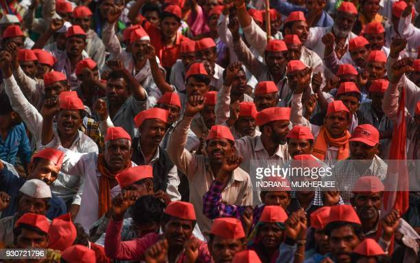 Indian farmers shout slogans as they listen to speakers at the site of a protest rally in Mumbai on March 12 2018 Tens of thousands of Indian farmers...