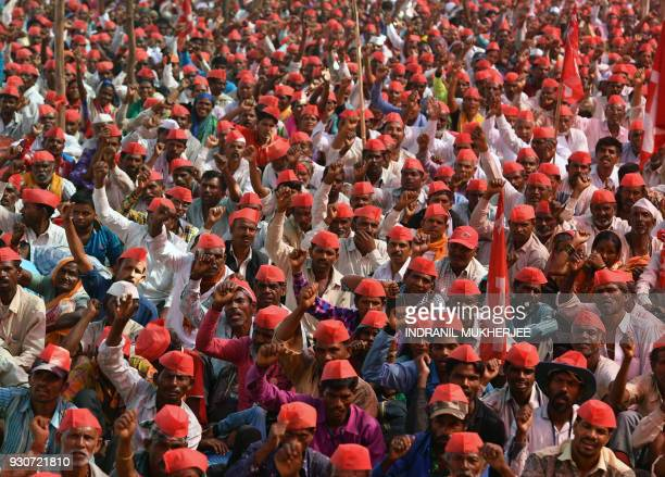 TOPSHOT Indian farmers shout slogans as they listen to speakers at the site of a protest rally in Mumbai on March 12 2018 Tens of thousands of Indian...