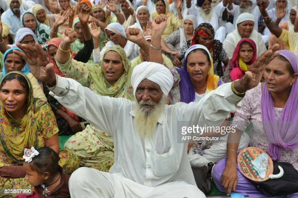 Indian farmers shoutslogans during a protest against the Punjab State Electricity Regulatory Commission and state government rise of electricity...