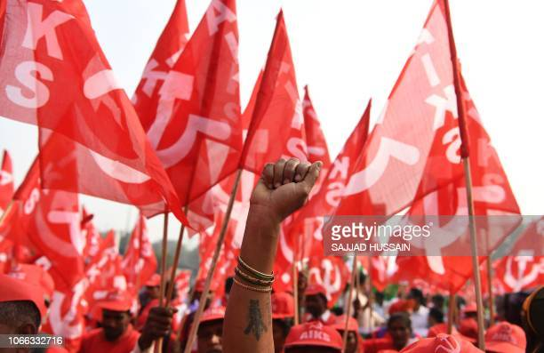 TOPSHOT Indian farmers take part in a march organised by the All India Kisan Sabha organization and Communist Party of India alongwith other leftist...