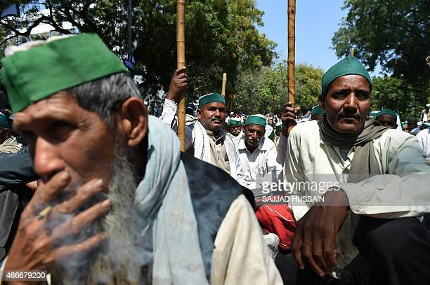 Indian farmers take part in a protest rally against land reforms proposed by Prime Minister Narendra Modi which they say will harm the country's...