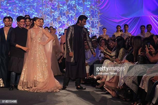 Indian fashion designer Manish Malhotra with Bollywood actors Arjun Kapoor and Jacqueline Fernandez during the opening show of Lakme Fashion Week...