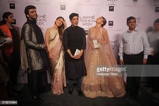 Indian Fashion designer Manish Malhotra with Bollywood actors Kareena Kapoor Khan Arjun Kapoor and Jacqueline Fernandez during the opening show of...