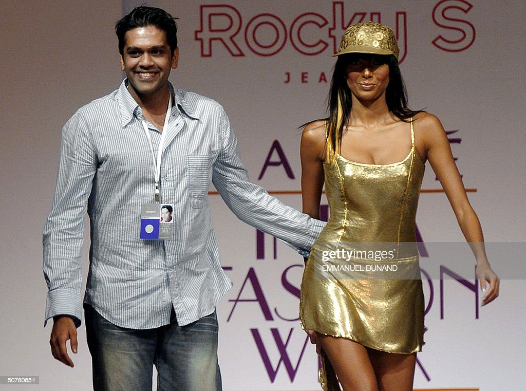 Indian Fashion Designer Rocky S Walks With A Model On The Catwalk At News Photo Getty Images