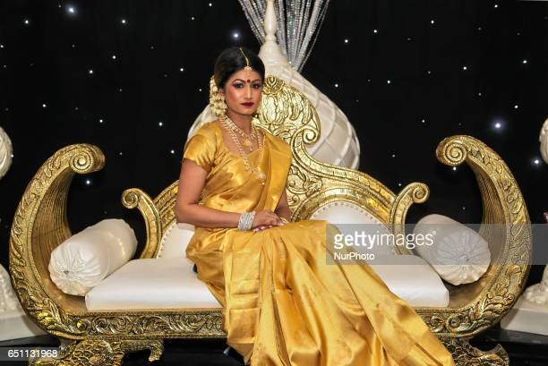 Indian fashion model wearing an elegant and ornate Kanchipuram saree during a South Asian bridal show held in Scarborough Ontario Canada