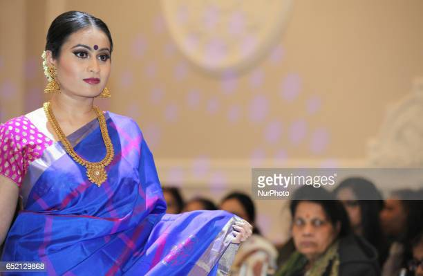 Indian fashion model wearing an elegant and ornate Kanchipuram saree during a South Asian bridal fashion show held in Scarborough Ontario Canada