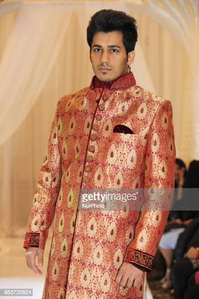 Indian fashion model wearing an ornate Sherwani suit during a South Asian bridal fashion show held in Scarborough Ontario Canada