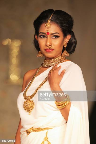 Indian fashion model wearing elegant and ornate jewellery during a South Asian bridal fashion show held in Scarborough Ontario Canada