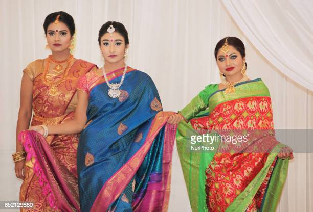 Indian fashion models wearing elegant and ornate Kanchipuram sarees during a South Asian bridal fashion show held in Scarborough Ontario Canada