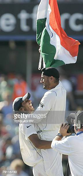 Indian fast bowler Ishant Sharma hoists 12th man Harbhajan Singh and the Indian flag in jubilation at winning the third Test against Australia by 72...