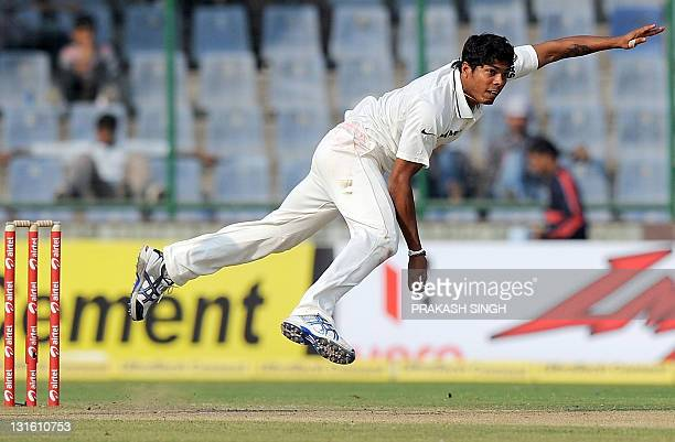Indian fastbowler Umesh Yadav bowls during the first day of the first Test match between Indian and West Indies at the Feroze Shah Kotla Stadium in...