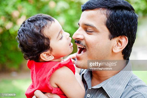 indian father playing with her little daughter showing affection - indian girl kissing stock photos and pictures