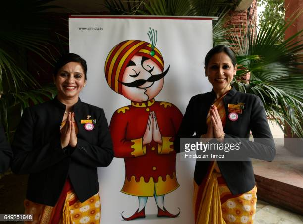 Indian female Cabin Crew of Air India pose for a photograph after their ceremony on the eve of international women's day on March 7 2017 in New Delhi...