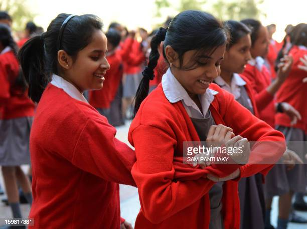 Indian female high school students try out basic Judo skills as they participate in a camp for self defense in Ahmedabad on January 21 2013...