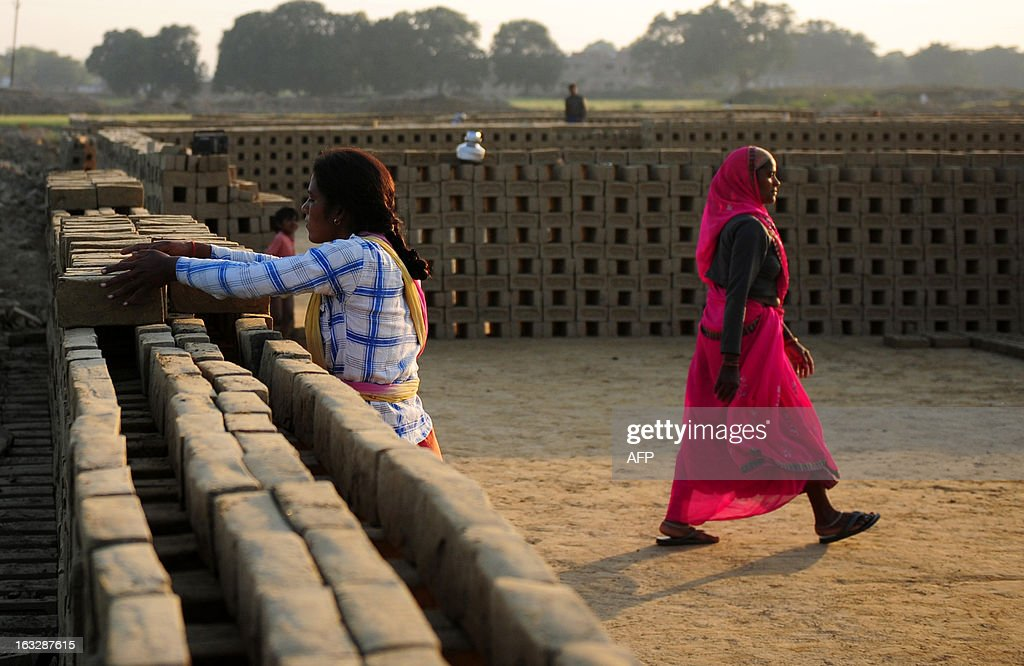 Indian female labourers work at a brick factory in Allahabad on March 7, 2013, on the eve of International Women's Day. Women have always faced higher unemployment rates than men, and the sluggish global economy in recent years has only made the situation worse, the International Labour Organisation said in December 2012. AFP PHOTO/ Sanjay KANOJIA