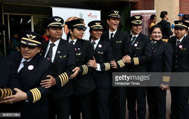 Indian female pilots of Air India pose for a photograph after their ceremony on the eve of international women's day on March 7 2017 in New Delhi...