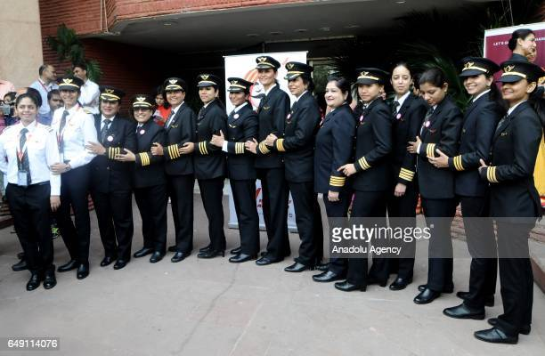 Indian female pilots of Air India the country's state owned carrier pose for a photograph after their ceremony on the eve of international women's...
