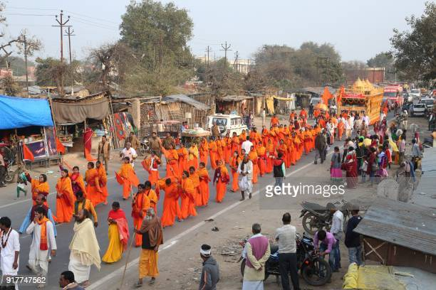 Indian female Sadhus welcome the Ram Rajya Rath Yatra as they parade along a road in Ayodhya on February 13 2018 The 'Ram Rajya Rath Yatra'...