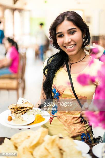 Indian female student in restaurant buffet