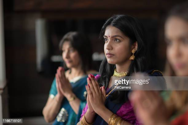 indian females praying one afternoon in their living room - tradition stock pictures, royalty-free photos & images