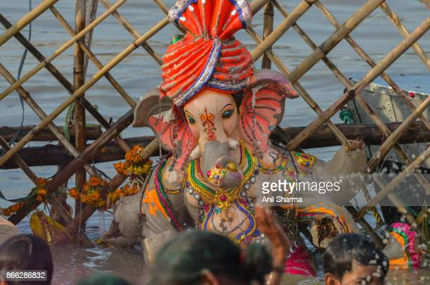indian festivals: ganesh chaturthi -4 - river yamuna stock pictures, royalty-free photos & images