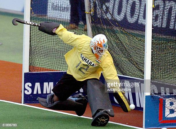 Indian field hockey goalkeeper Adrian D'Souza stretches but can not save a goal scored by Pakistani player Sohail Abbas during the sixnation...
