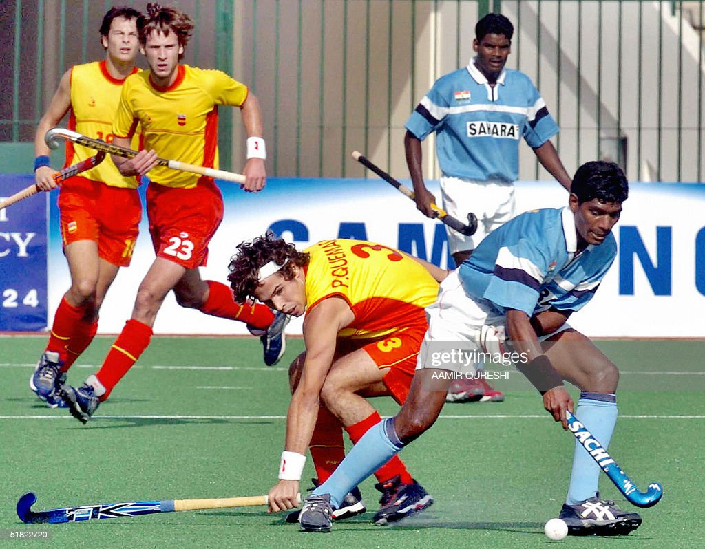Indian Field Hockey Player William Xalxo R Is Tackled By Spains Quemada Pau