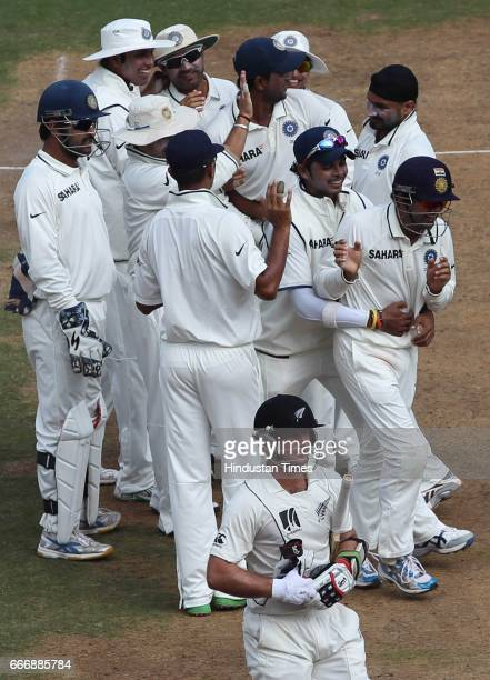 Indian fielder Gautam Gambhir celebrates with teamates after he took catch of New Zealand batsman Gareth Hopkins off Harbhajan Singh's bowling on the...