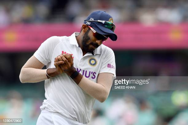 Indian fielder Jasprit Bumrah takes a successful catch to dismiss Australian batsman Matthew Wade off Ravindra Jadeja on day two of the third cricket...