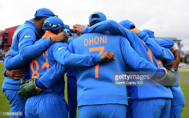 Indian fielders huddle before taking the field during the Group Stage match of the ICC Cricket World Cup 2019 between Pakistan and India at Old...