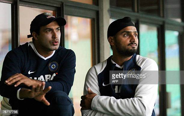 Indian fielding coach Robin Singh and Indian off spinner Harbhajan Singh in converse as rain delays the start of play between India and Scotland...