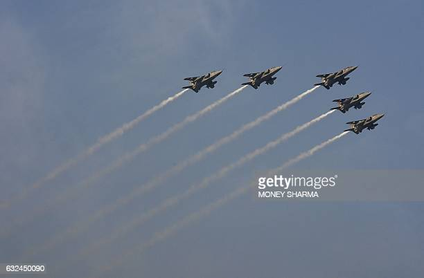 Indian fighter aircraft fly past during the full dress rehearsal for the upcoming Indian Republic Day parade in New Delhi on January 23 2017 Crown...