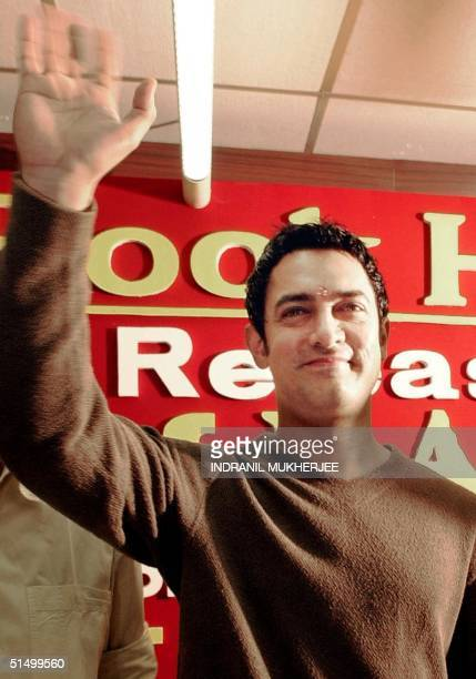 Indian film actor Aamir Khan waves to fans at a book store in Bangalore 14 April 2002 Khan whose film Lagaan was nominated for this year's Oscars in...