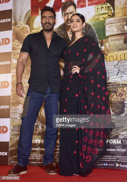 Indian film actor Ajay Devgn and Ileana D'Cruz pose during trailer launch of their upcoming film Raid at PVR Juhu in Mumbai