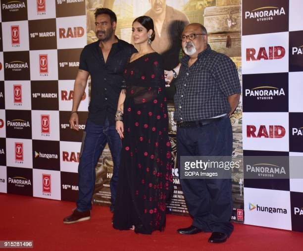 Indian film actor Ajay Devgn Ileana D'Cruz Saurabh Shukla pose during trailer launch of their upcoming film Raid at PVR Juhu in Mumbai