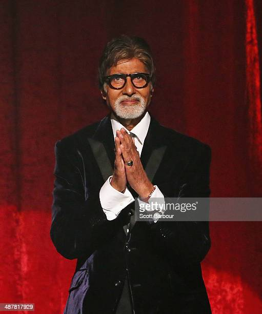 Indian film actor Amitabh Bachchan gestures on stage as he is presented with the International Screen Icon Award during the Indian Film Festival of...